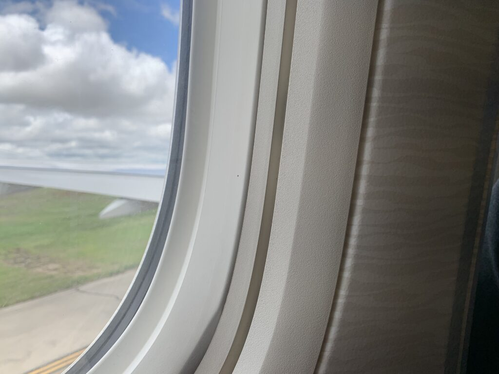 Looking out at the plane wing